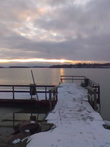 sunset and snow on pier