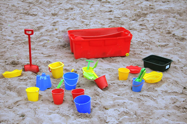 spades and buckets on sand
