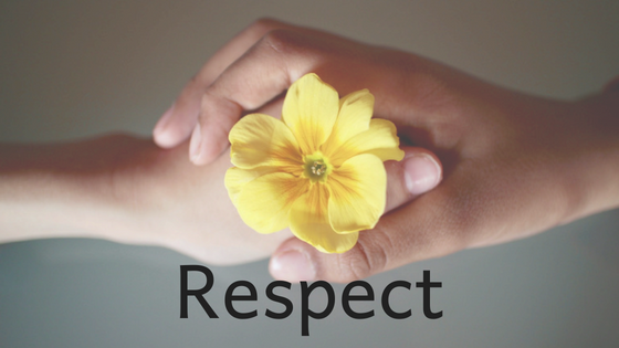 hands holding a yellow flower