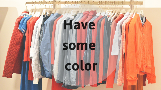colourful shirts hanging on a rack