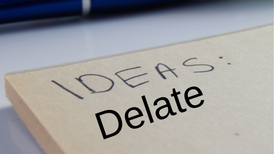 ideas and delate words on white pad