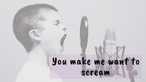 boy screaming into a mic