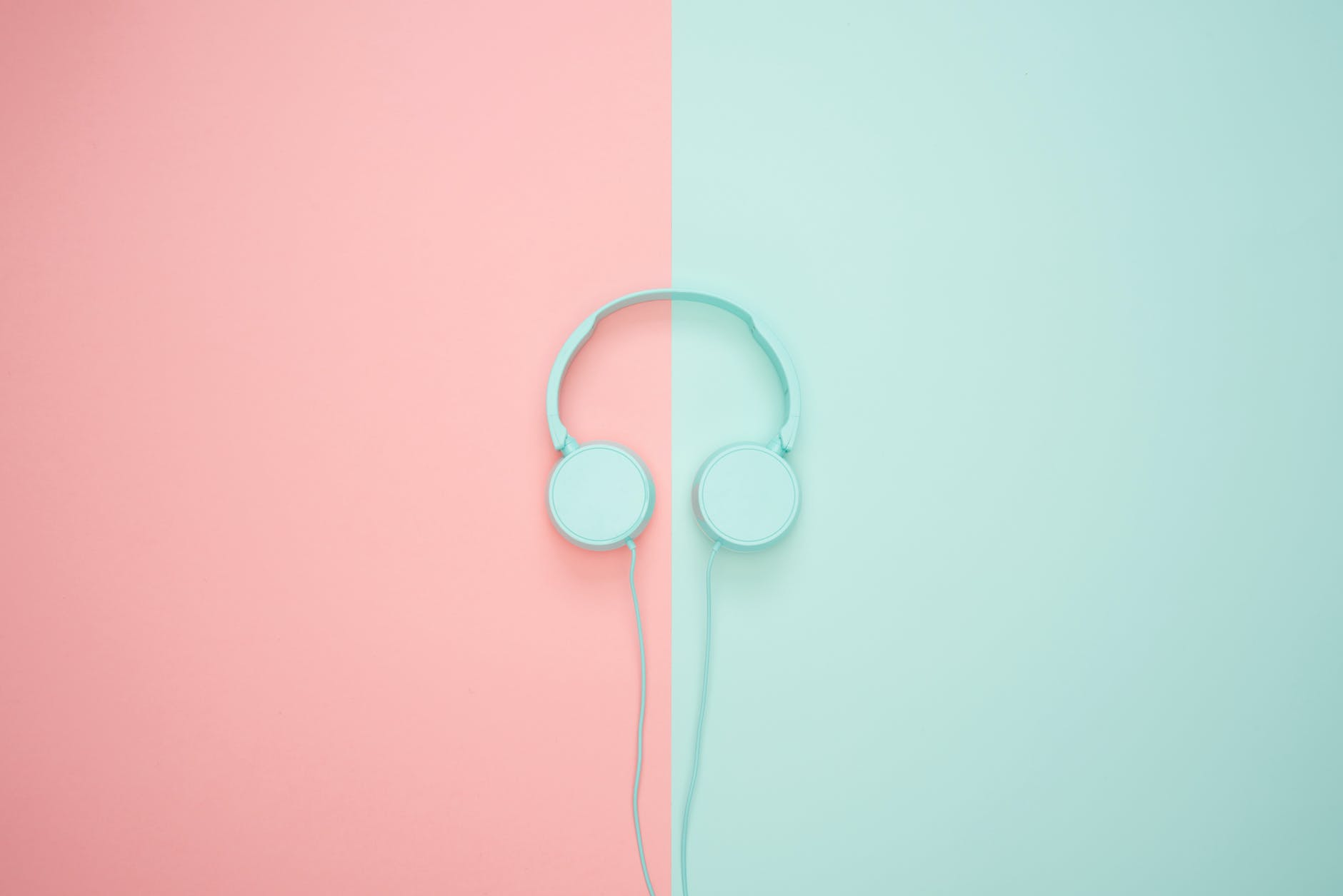 pastel colour earphones on pastel background