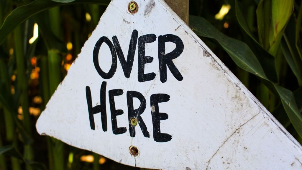 over here sign
