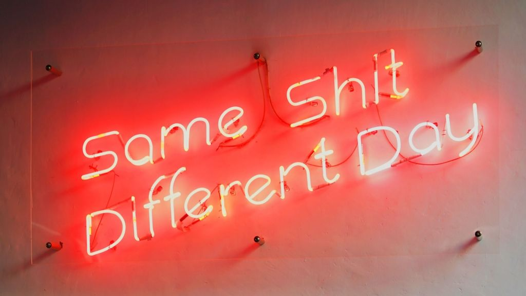 red and white neon sign